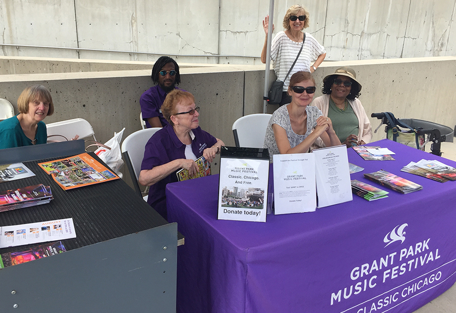 Festival volunteers staff the welcome tent during a Grant Park Orchestra rehearsal