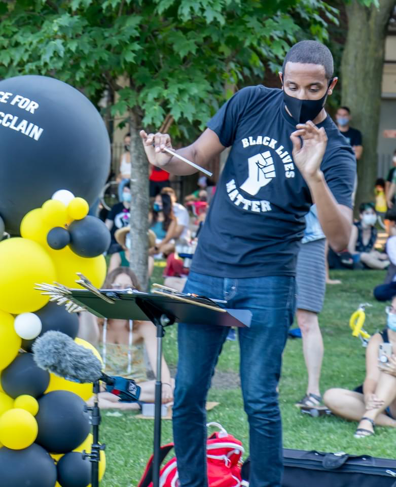 Kyle Dickson on the podium at the Elijah McClain vigil in Chicago's Oz Park